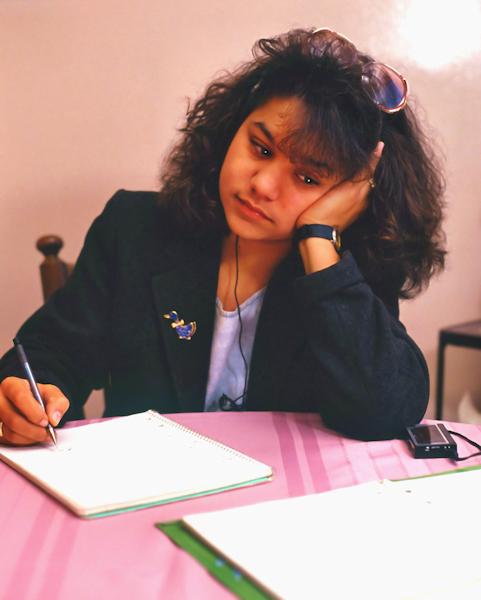 Girl making her home work